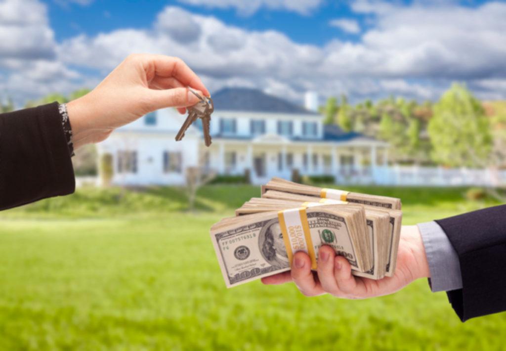 Handing Over Keys Money for House Flipping